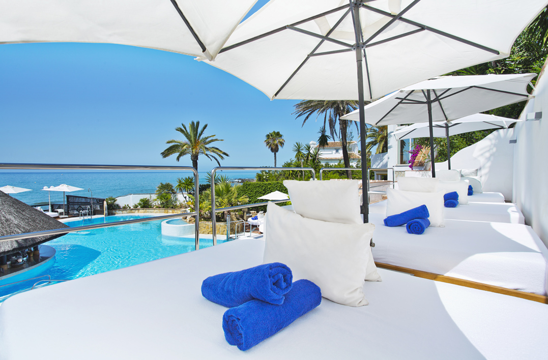 Luxury Sun Bathing, El Oceano Hotel, white sun beds, Blue sky, blue sea, blue towels, La Cala Hotel, Mijas Costa Beach, La Cala Beach Mijas